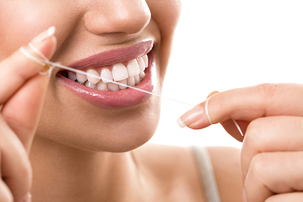 closeup the importance of flossing